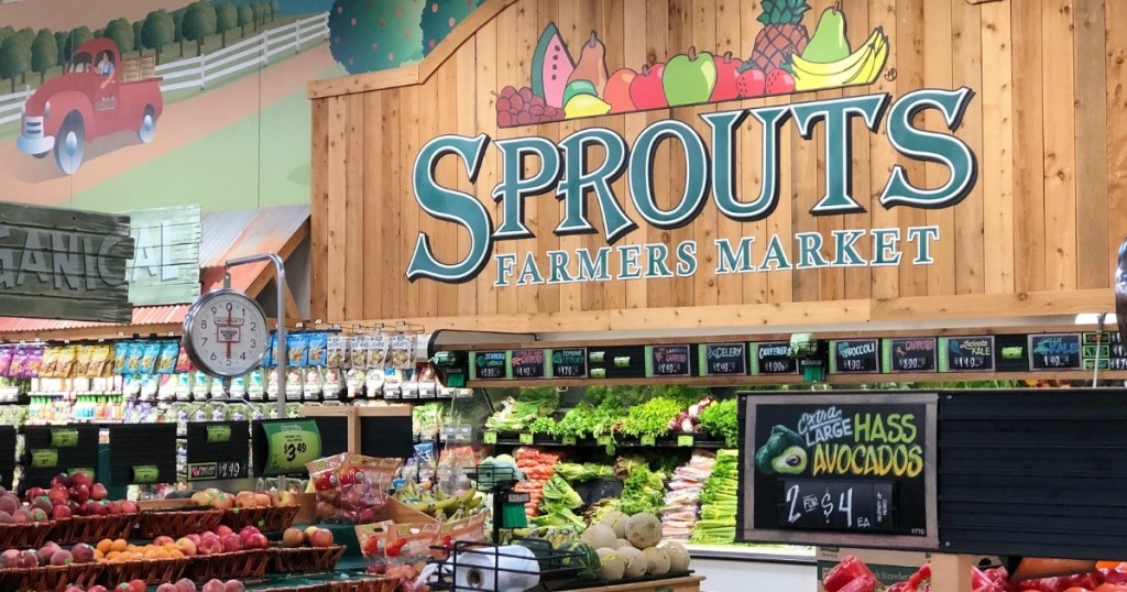 sprouts sign in produce section at grocery store
