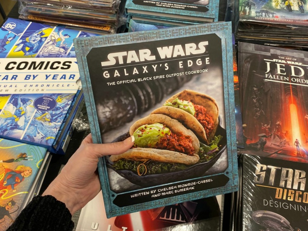 Star Wars Cookbok in hand on display in store