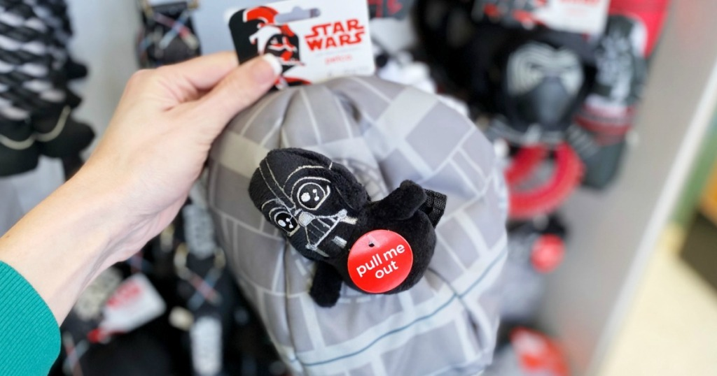 hand holding a Star Wars Plush Toy