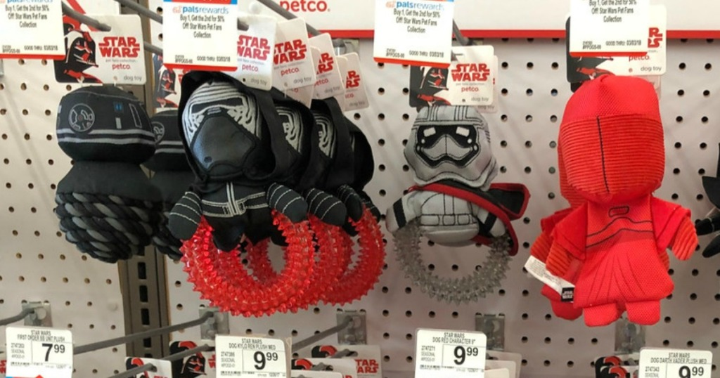 Star Wars Ring Toys hanging on pegs at Petco