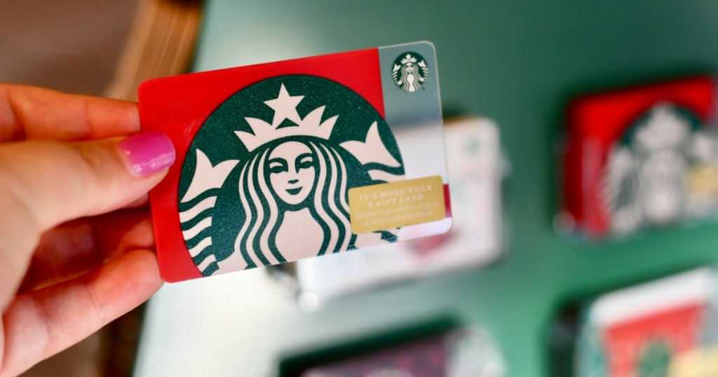 Woman holding Starbucks Gift Card