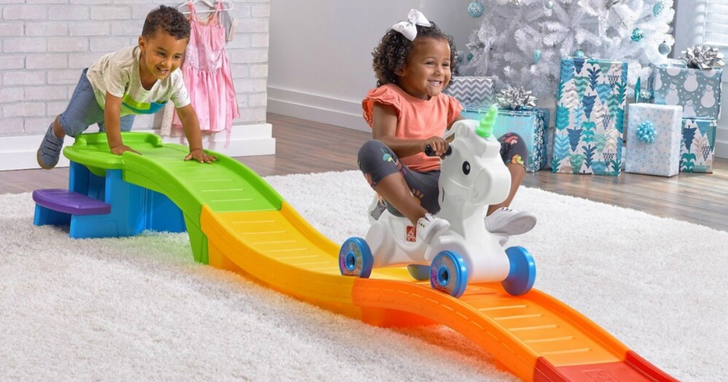 girl riding Step2 Unicorn Coaster