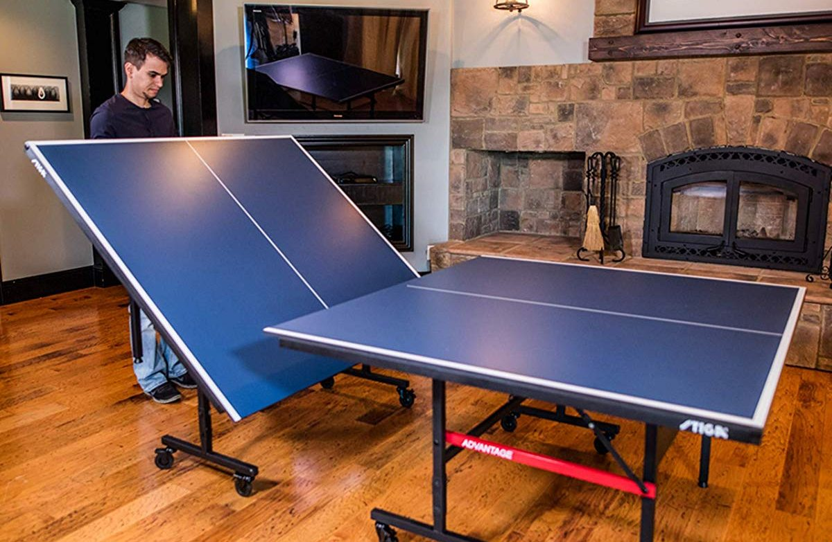 man setting up a Stiga Table Tennis Table