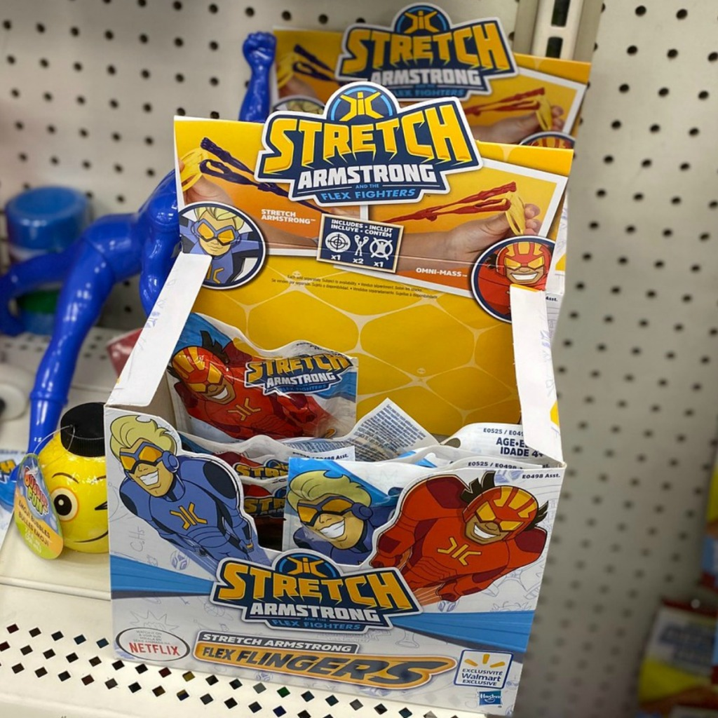 Stretch Armstrong flex figures in display box at Dollar Tree