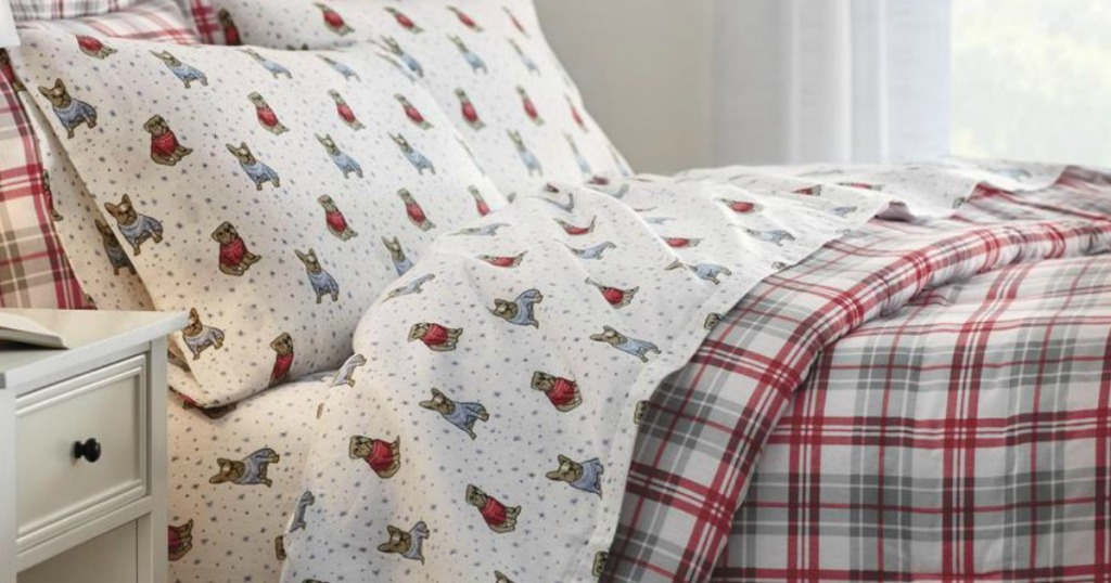 bed with StyleWell comforter set and sheets on it