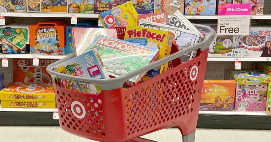 A bunch of board games in a big red Target shopping cart