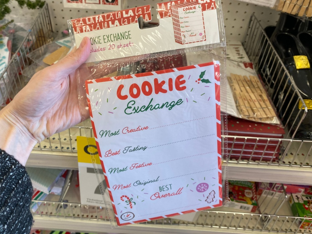 Hand holding Cookie Exchange Sheets at Target