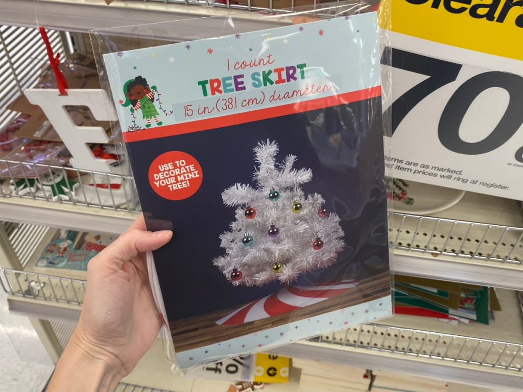 Hand Holding mini Christmas Tree skirt at Target