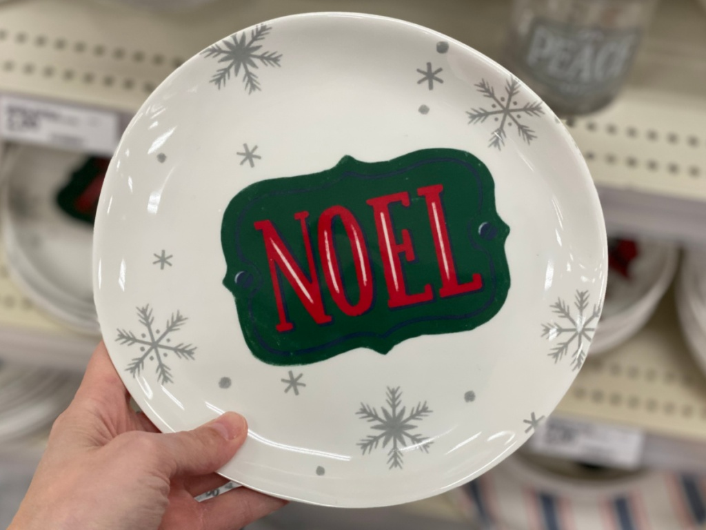 Hand holding holiday plates at Target