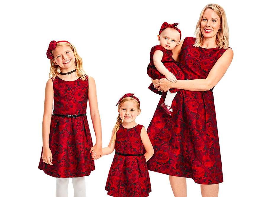 family wearing The Children's Place Matching Dresses