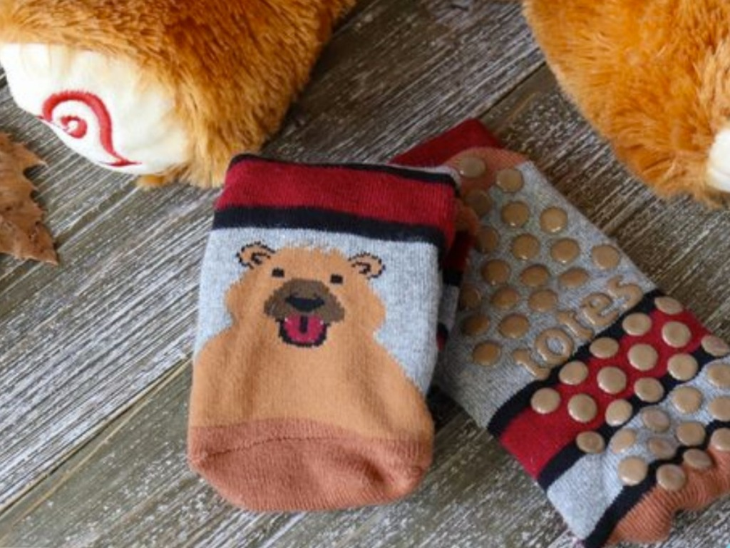 Bear themed- kids slipper socks near teddy bear