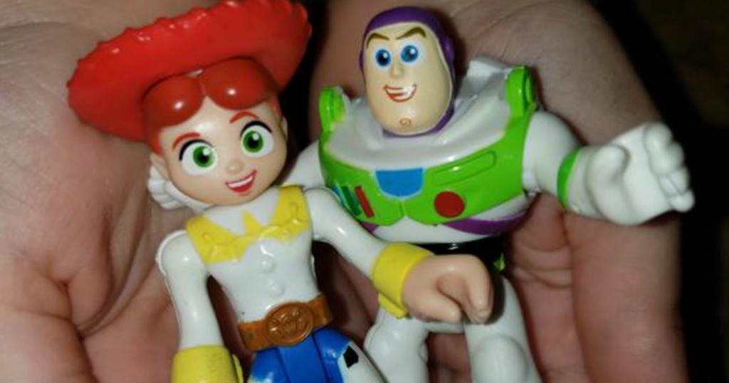 Toy Story Buzz Lightyear and Jessie Figures being held in a persons hand
