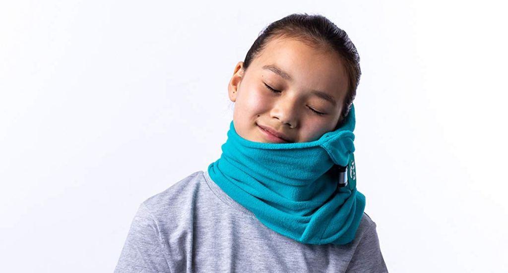 girl using a Trtl Kids Pillow