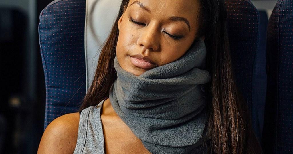 woman using a Trtl Travel Pillow