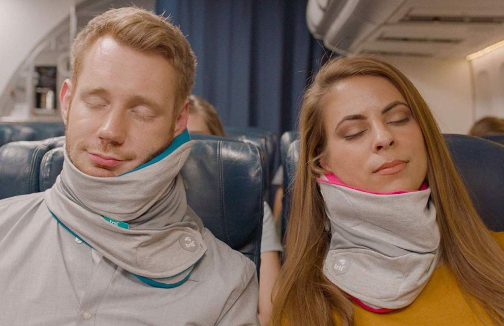 people using Trtl Travel Pillows on a plane