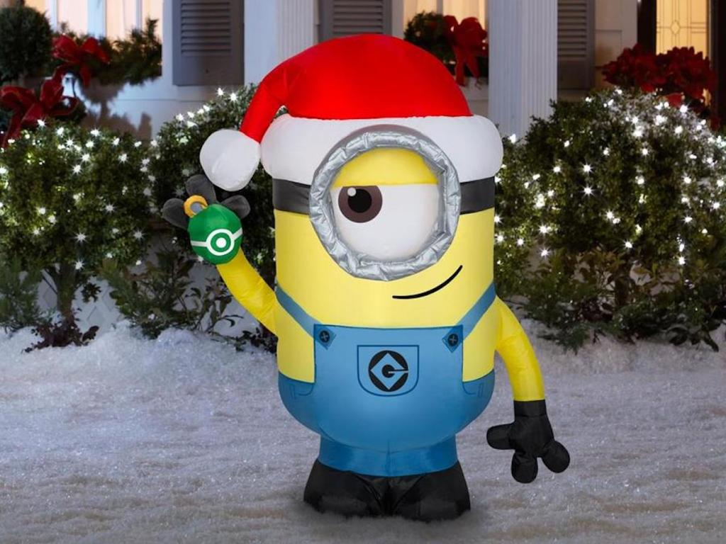 Universal Lighted Minion Christmas Inflatable in snowy yard