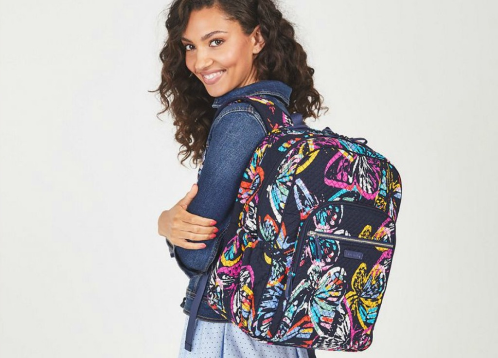 woman wearing multi-colored backpack