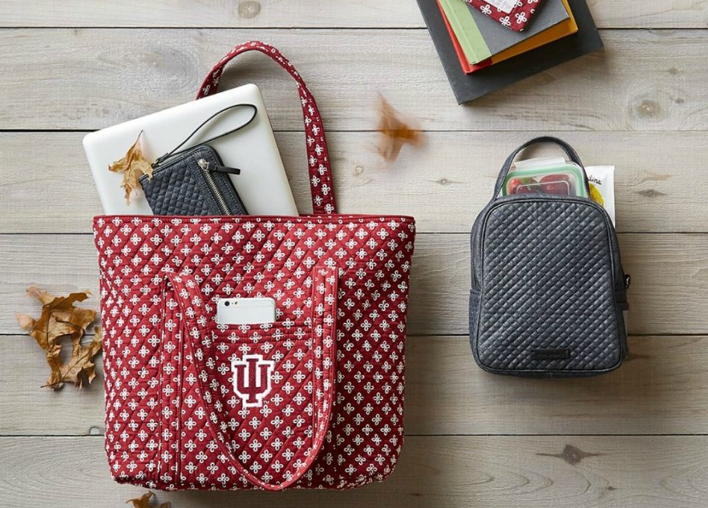 Vera Bradley Collegiate Tote Bag full of items next to a gray lunch bag