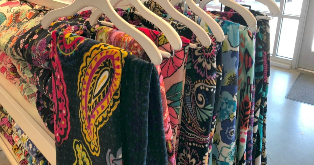 colorful blankets hanging on a rack