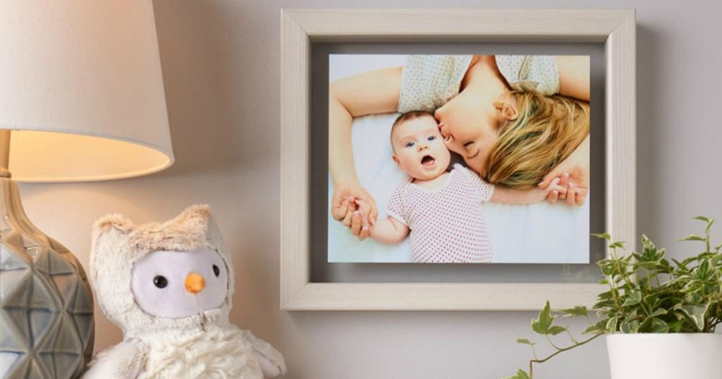 floating frame with a picture of a woman and a baby