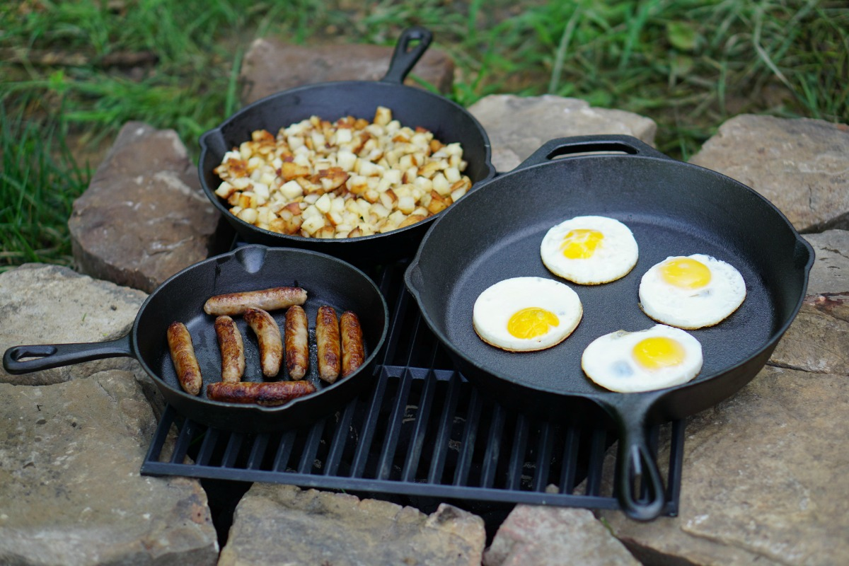 Three Ozark Cast Iron Skillet with breakfast foods at camp