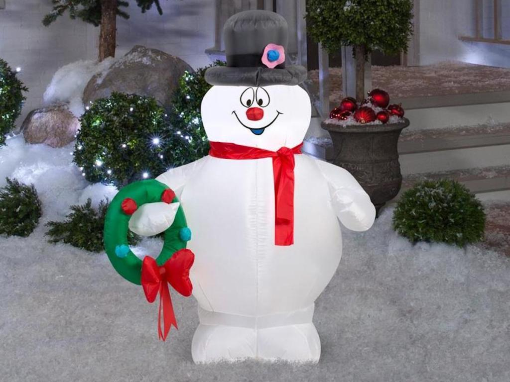 Warner Brothers Lighted Frosty Christmas Inflatable in front yard