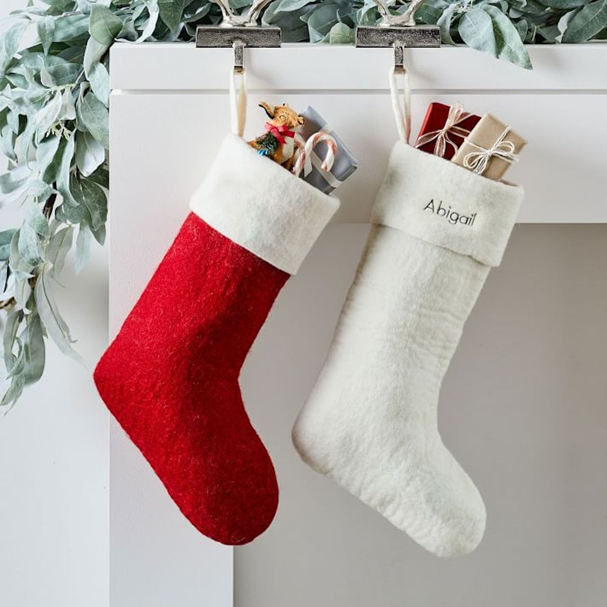 West Elm Felt Christmas Stocking red and white on mantal