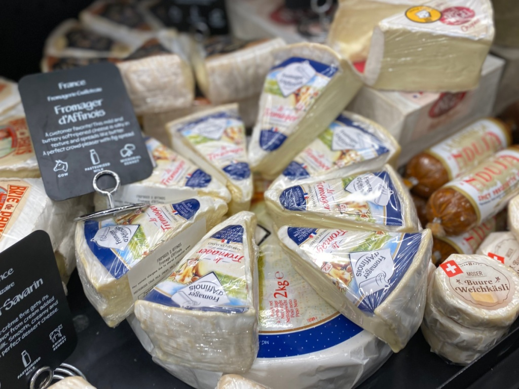 soft cheese in dairy case at whole foods