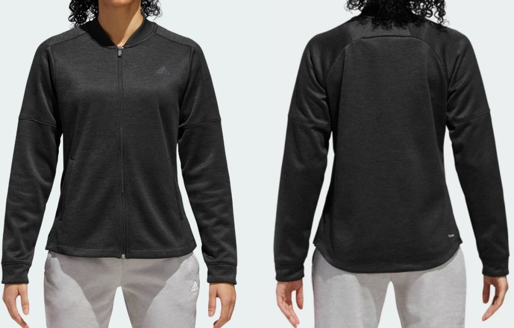 Woman wearing a black adidas jacket - front and back view