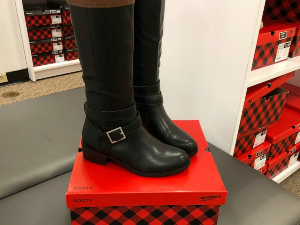 women's boots on box in store