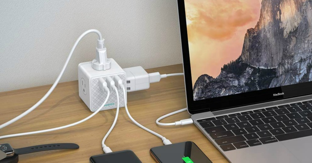 Xcentz Power Strip Cube with laptop and twp phones plugged into to charge