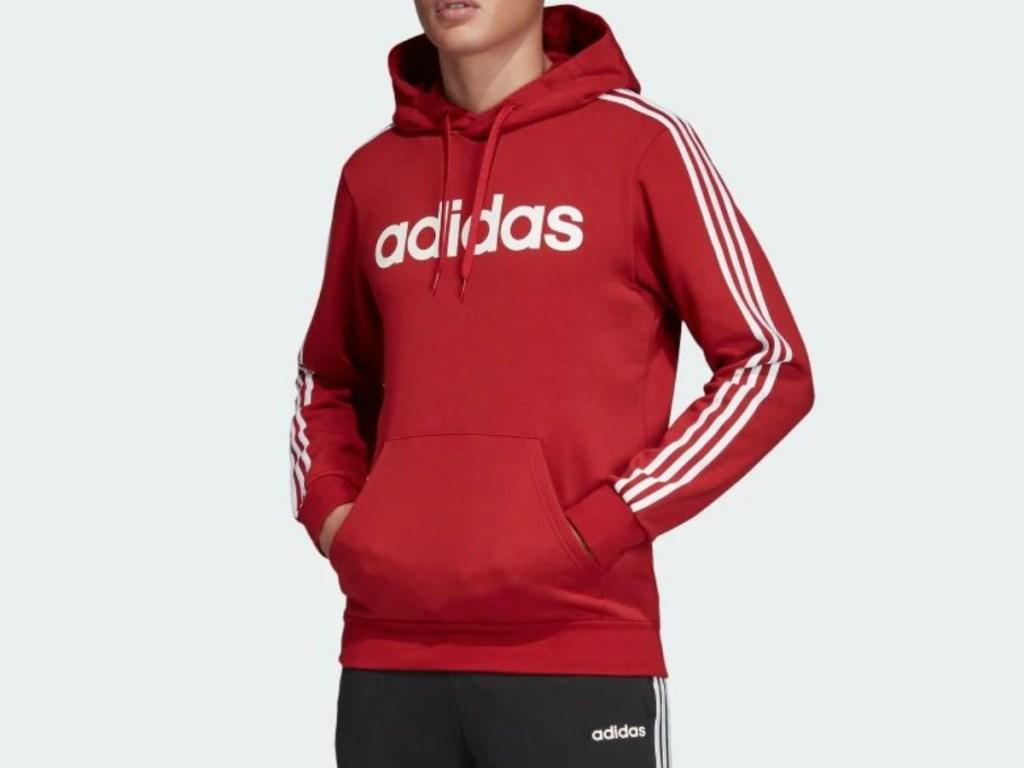 teenager wearing red hoodie and black pants