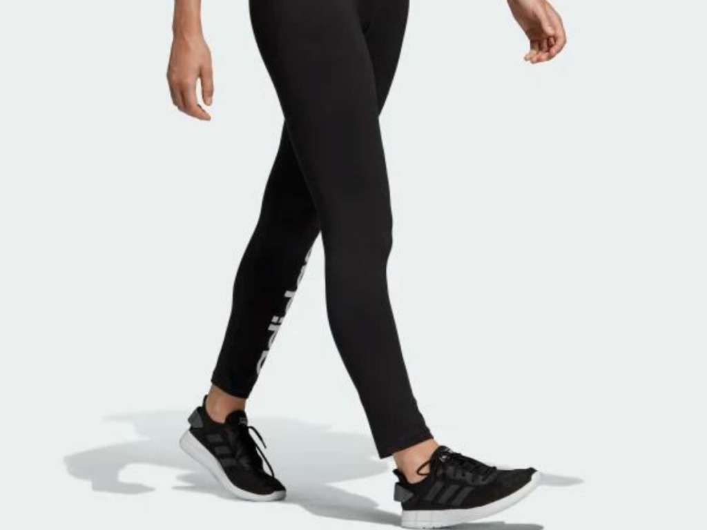 woman walking in tights and tennis shoes