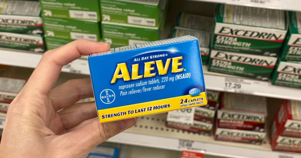 hand holding up box of aleve pain reliever