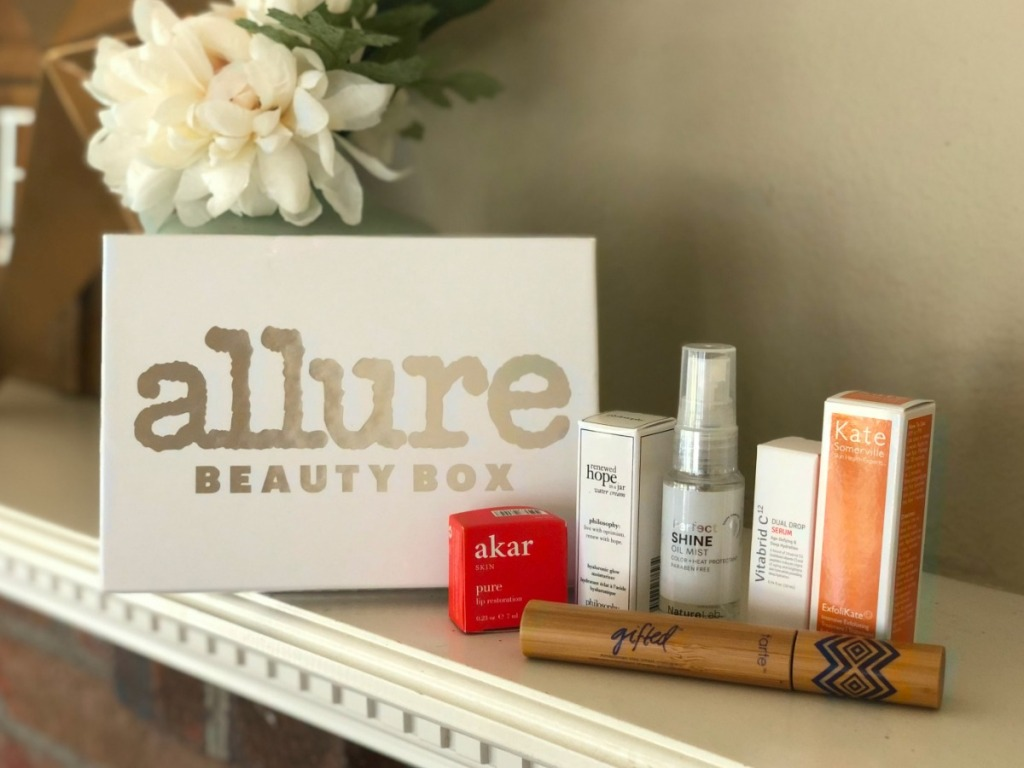 box, flowers, and several beauty products on shelf