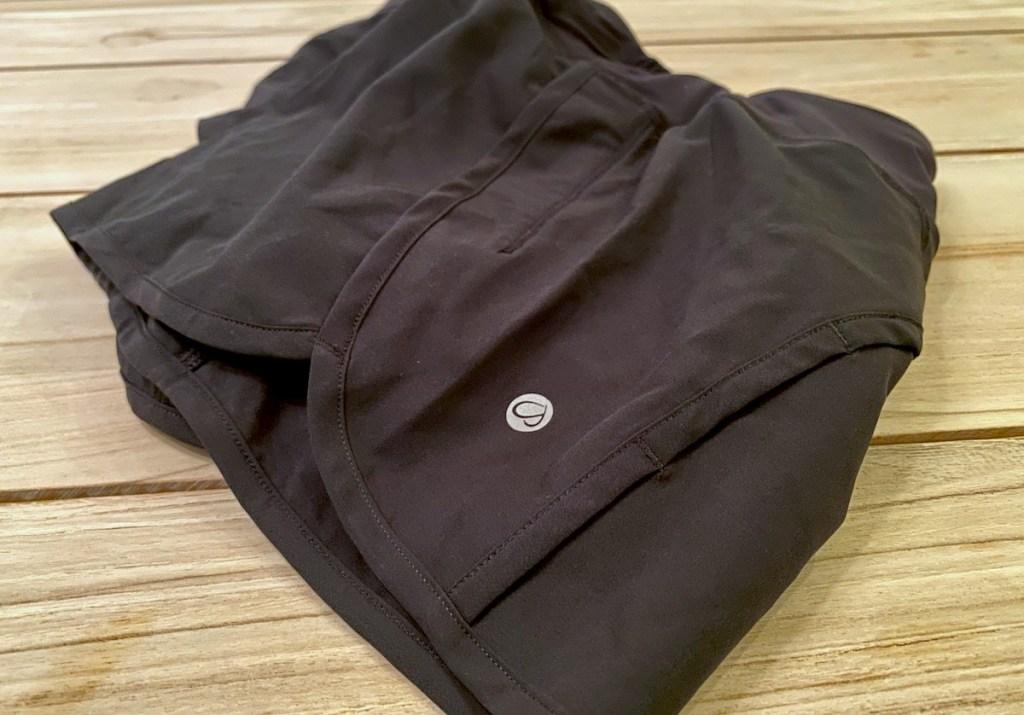 black shorts sitting on wood surface