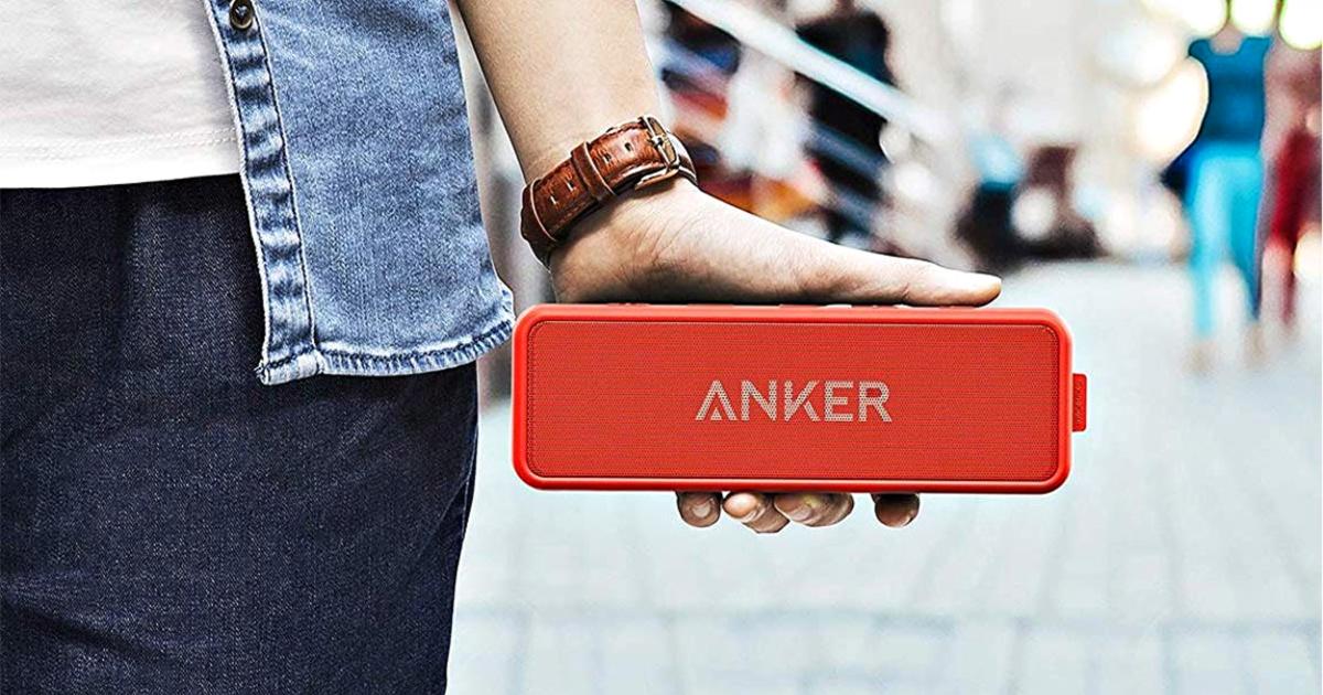 hand holding red anker bluetooth speaker
