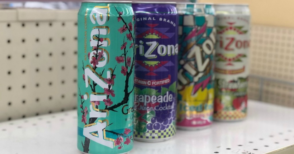 four cans of tea sitting on store shelf