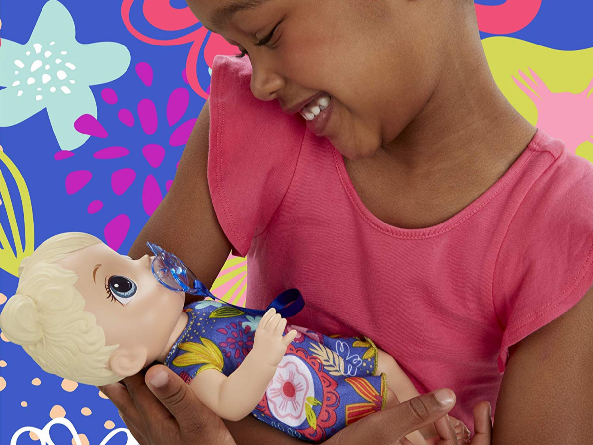 little girl playing with baby alive doll
