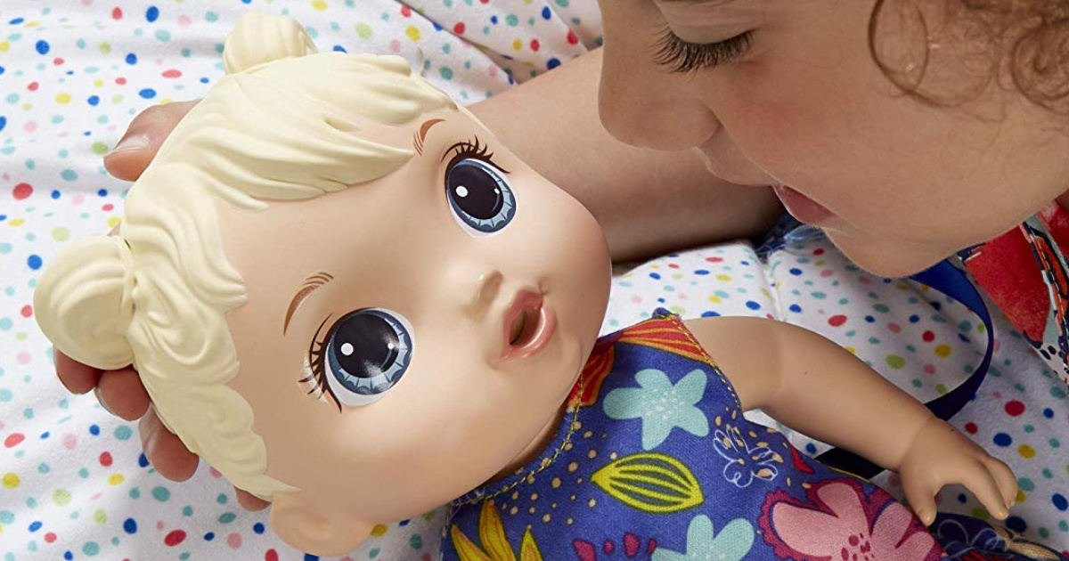 little girl with baby alive doll