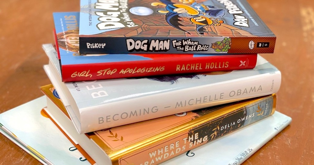 stack of kids and adult books