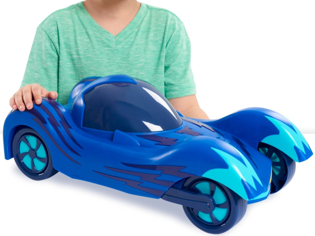 boy with PJ Masks Mega Vehicle Catboy's Cat-Car