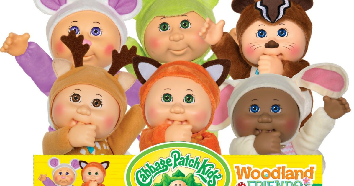 stock image of Cabbage Patch dolls in woodland outfits