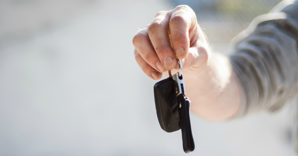 car rental person holding car keys
