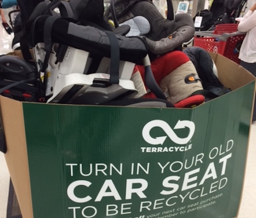 green terracycle box filled with used car seats