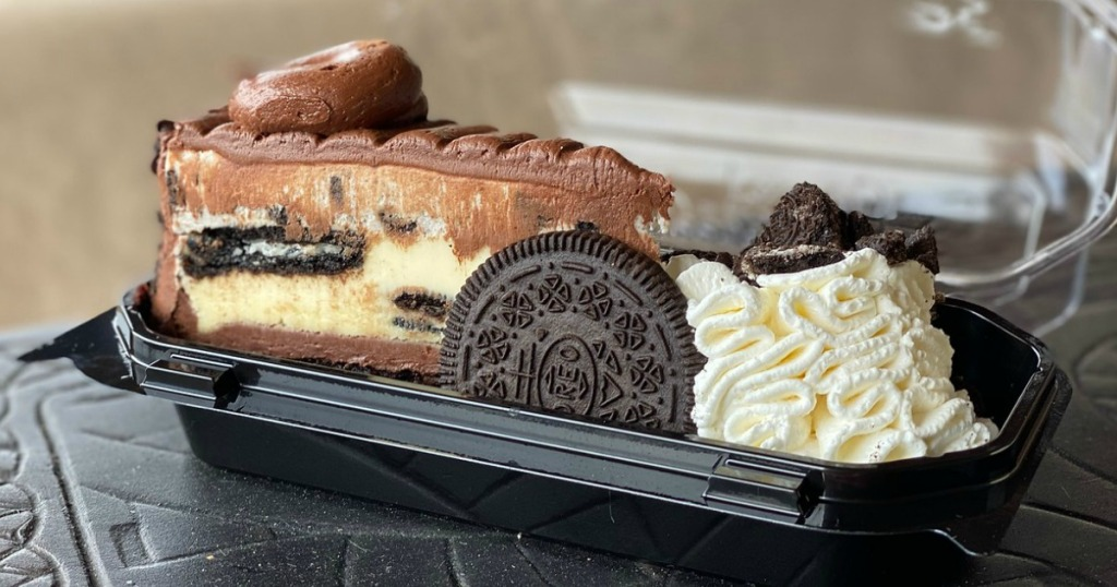 slice of cheesecake with oreo in to-go container