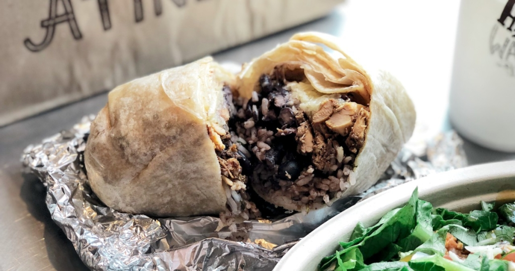 picture of cut open Chipotle burrito iwth black beans, chicken, cheese, and more