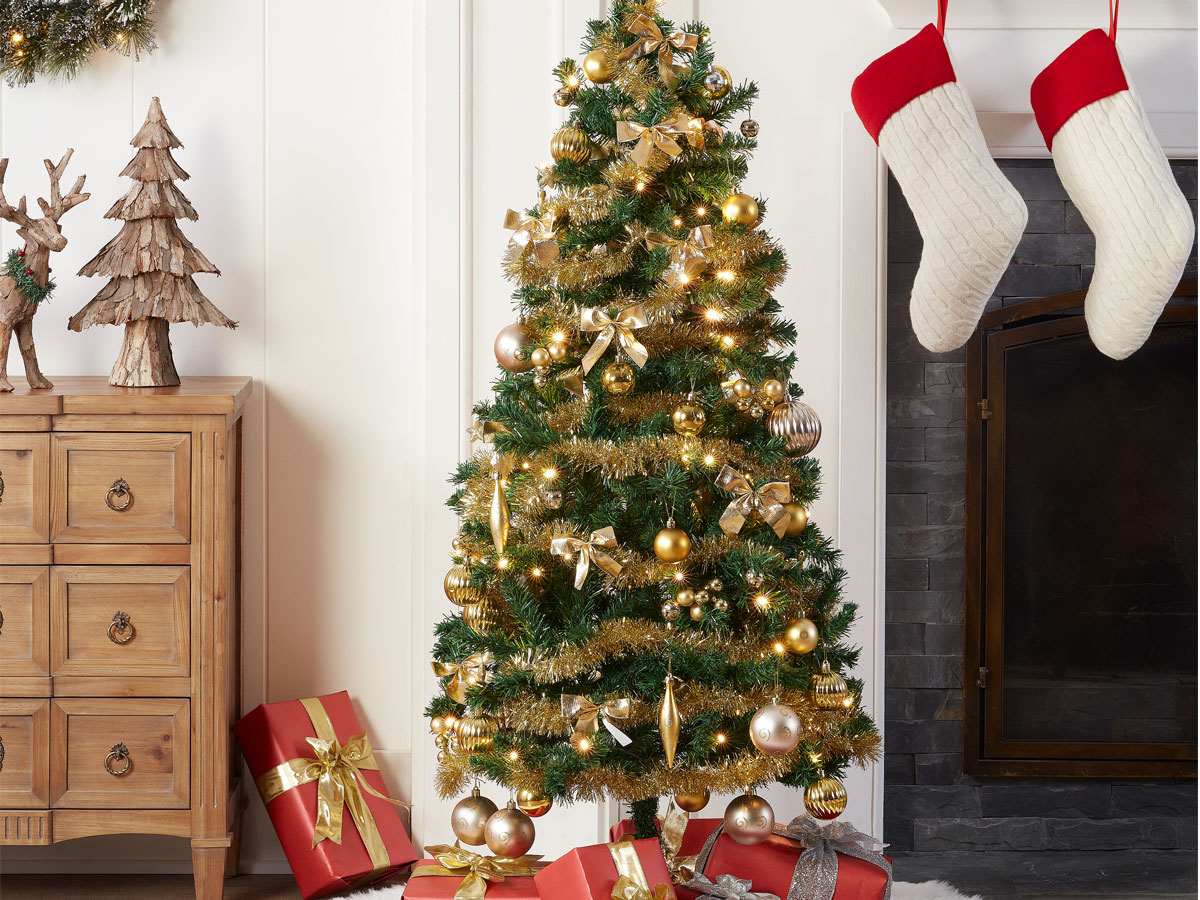 Holiday Time Pre-Lit Christmas Tree 5 ft with Decorations, Gold in a home