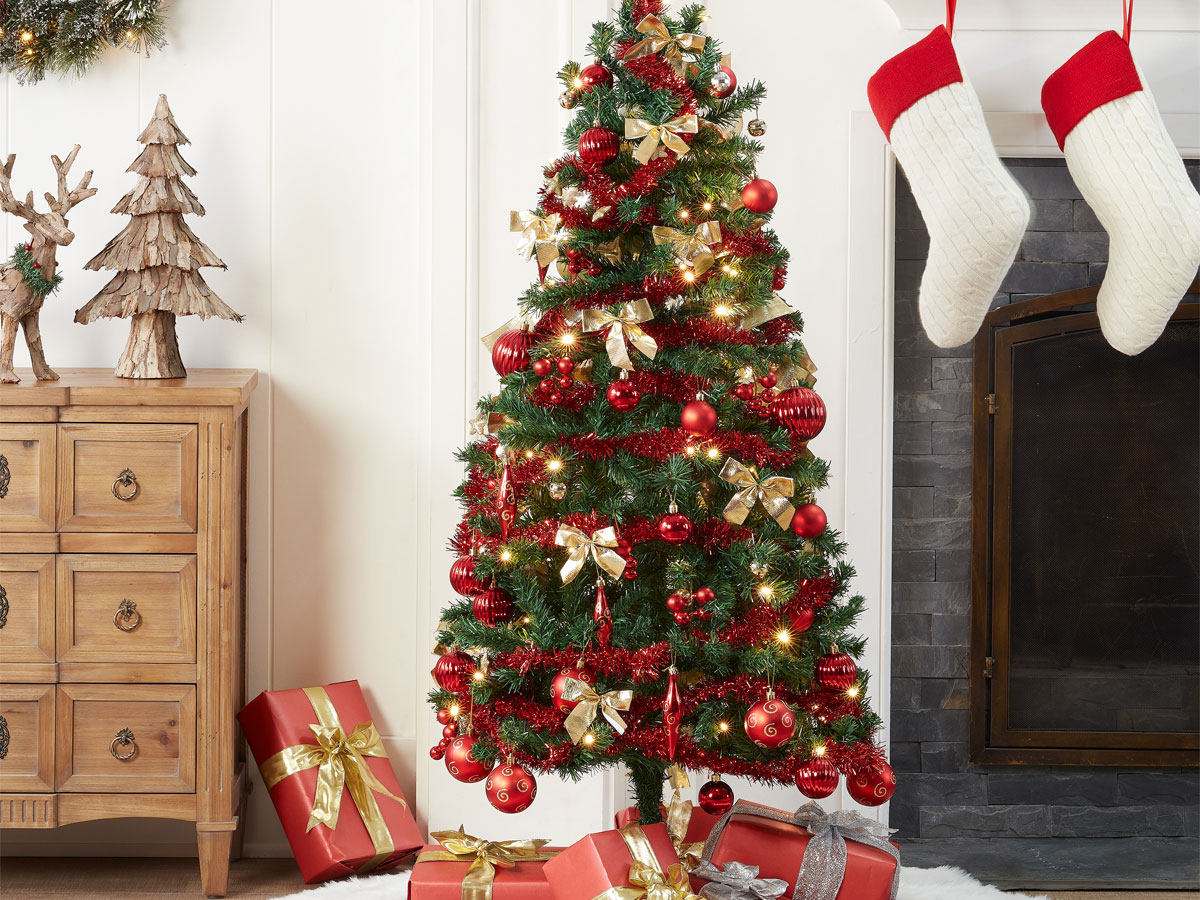 Holiday Time Pre-Lit Christmas Tree 5 ft with Decorations - Red in a home