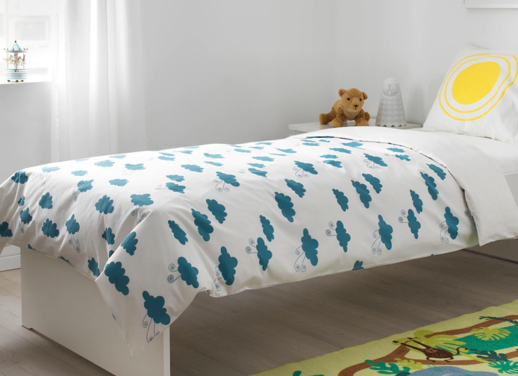 bedroom with white and blue cloud bedding on bed